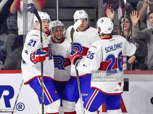 Daniel Audette of the Laval Rocket celebrates his third period goal with teammates against the Binghamton Devils during the AHL game at Place Bell on...