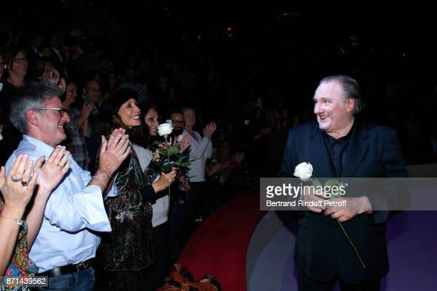 Daniel Auteuil and Marisa Berenson attending Gerard Depardieu acknowledges the applause of the audience and gives flowers at the end of 'Depardieu...