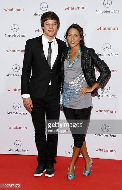 Daniel Axt and guest attend the What a man premiere at the Cinestar movie theater on August 10 2011 in Berlin Germany