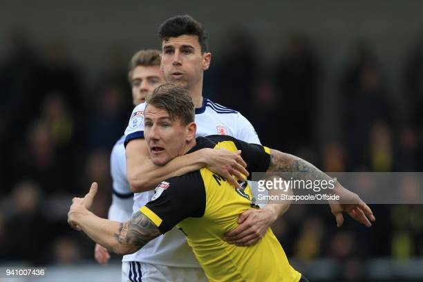 Daniel Ayala of Boro grapples wuth Kyle McFadzean of Burton during the Sky Bet Championship match between Burton Albion and Middlesbrough at the...
