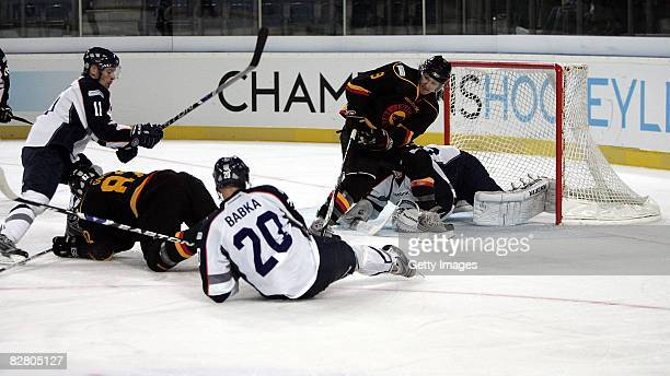 Daniel Babka of HC Kosice fighting for a goal against SC Bern during the  Champions Hockey 4d9cc41a8a5