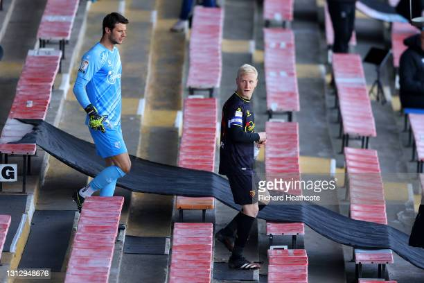 Daniel Bachmann and Will Hughes of Watford FC walk out to the field of play prior to the Sky Bet Championship match between Luton Town and Watford at...