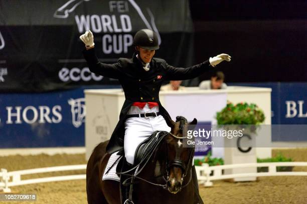 Daniel Bachmann Andersen of Denmark celebrate winning the competion with his horse Blue Hors Sack during the FEI World Cup Free Style Dressage on...