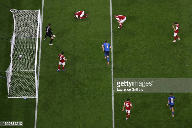Daniel Bachmann, David Alaba, Martin Hinteregger and Florian Grillitsch of Austria look dejected after the Italy first goal scored by Federico Chiesa...