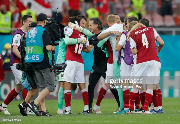 Daniel Bachmann of Austria celebrates their side's victory with team mate Alessandro Schoepf after the UEFA Euro 2020 Championship Group C match...