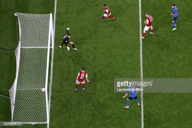 Daniel Bachmann of Austria looks on as Federico Chiesa of Italy scores their side's first goal during the UEFA Euro 2020 Championship Round of 16...