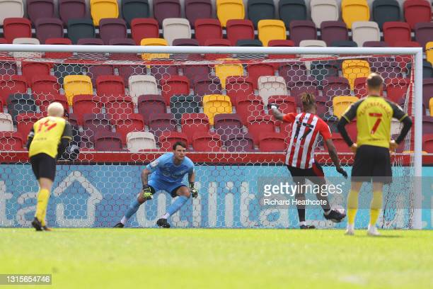 Daniel Bachmann of Watford fails to save a penalty from Ivan Toney of Brentford as he goes on to score his side's second goal during the Sky Bet...