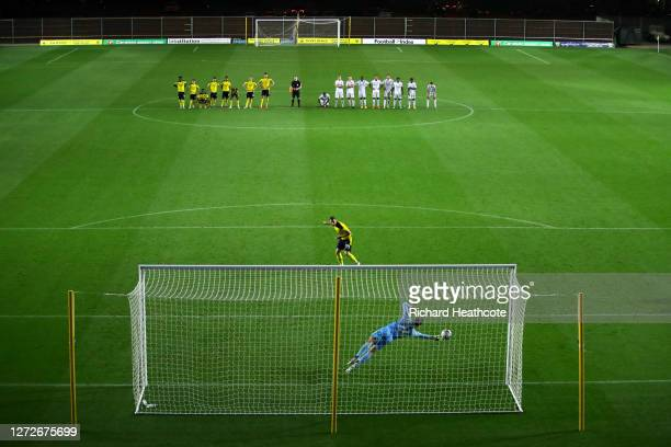 Daniel Bachmann of Watford saves the first penalty in the shootout from Anthony Forde of Oxford United during the Carabao Cup Second Round match...
