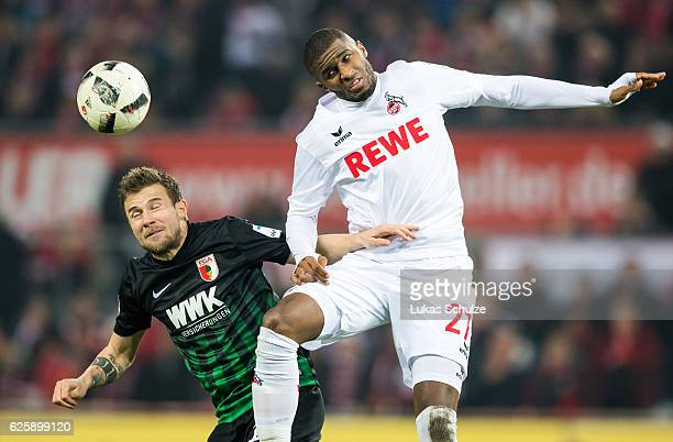 Daniel Baier of Augsburg and Anthony Modeste of Koeln in action during the Bundesliga match between 1 FC Koeln and FC Augsburg at RheinEnergieStadion...