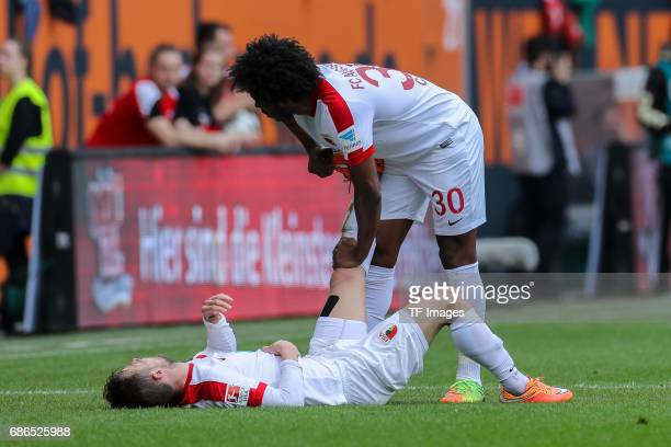 Daniel Baier of Augsburg and Caiuby Francisco da Silva of Augsburg looks on during the Bundesliga match between FC Augsburg and Borussia Dortmund at...