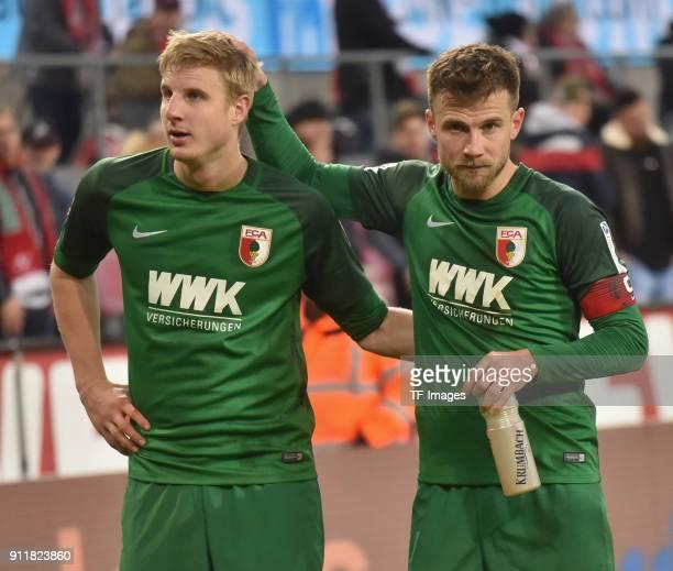 Daniel Baier of Augsburg and Martin Hinteregger look on after the Bundesliga match between 1 FC Koeln and FC Augsburg at RheinEnergieStadion on...