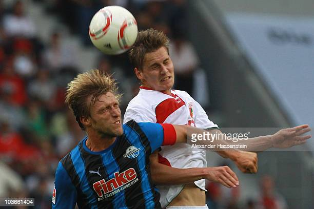 Daniel Baier of Augsburg battles for the ball with Markus Kroesche of Paderborn during the Second Bundesliga match between FC Augsburg and SC...