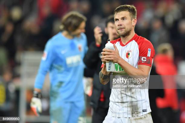 Daniel Baier of Augsburg celebrates after the Bundesliga match between FC Augsburg and RB Leipzig at WWKArena on September 19 2017 in Augsburg Germany