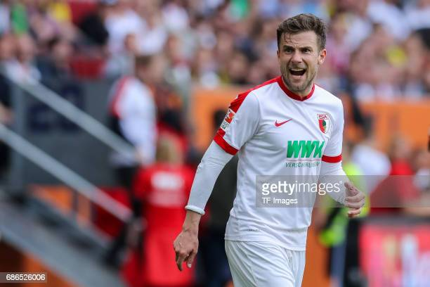 Daniel Baier of Augsburg gestures during the Bundesliga match between FC Augsburg and Borussia Dortmund at the WWKArena on May 13 2017 in Augsburg...