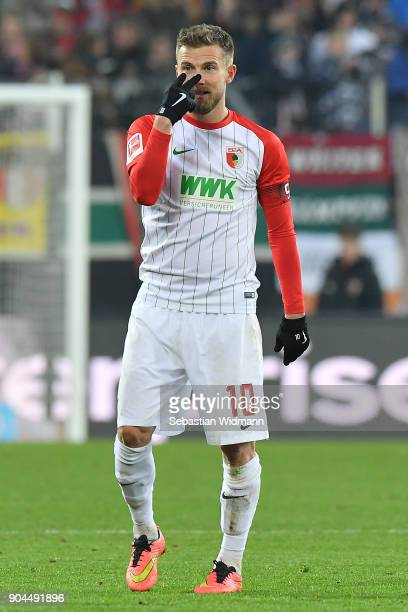 Daniel Baier of Augsburg gestures during the Bundesliga match between FC Augsburg and Hamburger SV at WWKArena on January 13 2018 in Augsburg Germany