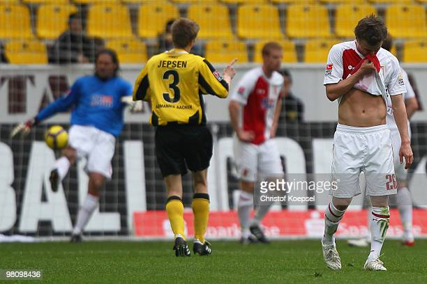 Daniel Baier of Augsburg looks dejected after the third goal of Aachen during the Second Bundesliga match between Alemannia Aachen and FC Augsburg at...
