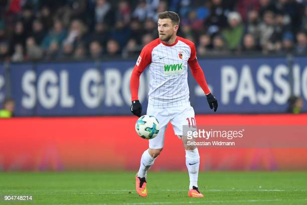 Daniel Baier of Augsburg plays the ball during the Bundesliga match between FC Augsburg and Hamburger SV at WWKArena on January 13 2018 in Augsburg...