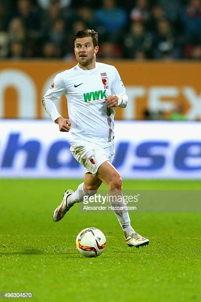 Daniel Baier of Augsburg runs with the ball during the Bundesliga match between FC Augsburg and SV Werder Bremen at WWK Arena on November 8 2015 in...