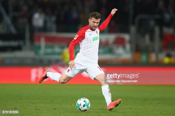 Daniel Baier of Augsburg runs with the ball during the Bundesliga match between FC Augsburg and VfL Wolfsburg at WWKArena on November 25 2017 in...