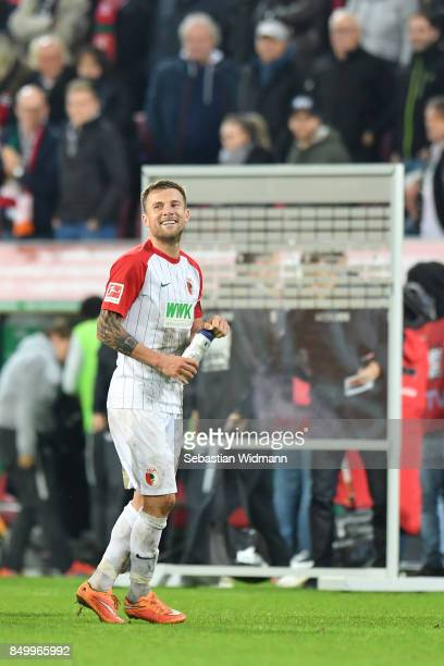 Daniel Baier of Augsburg smiles after the Bundesliga match between FC Augsburg and RB Leipzig at WWKArena on September 19 2017 in Augsburg Germany