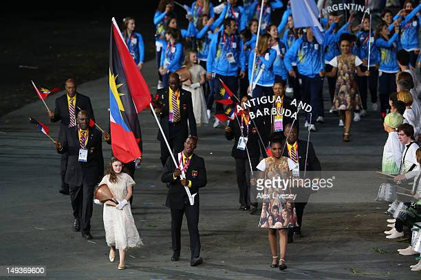 Daniel Bailey of the Antigua and Barbuda Olympic athletics team carries his country's flag during the Opening Ceremony of the London 2012 Olympic...