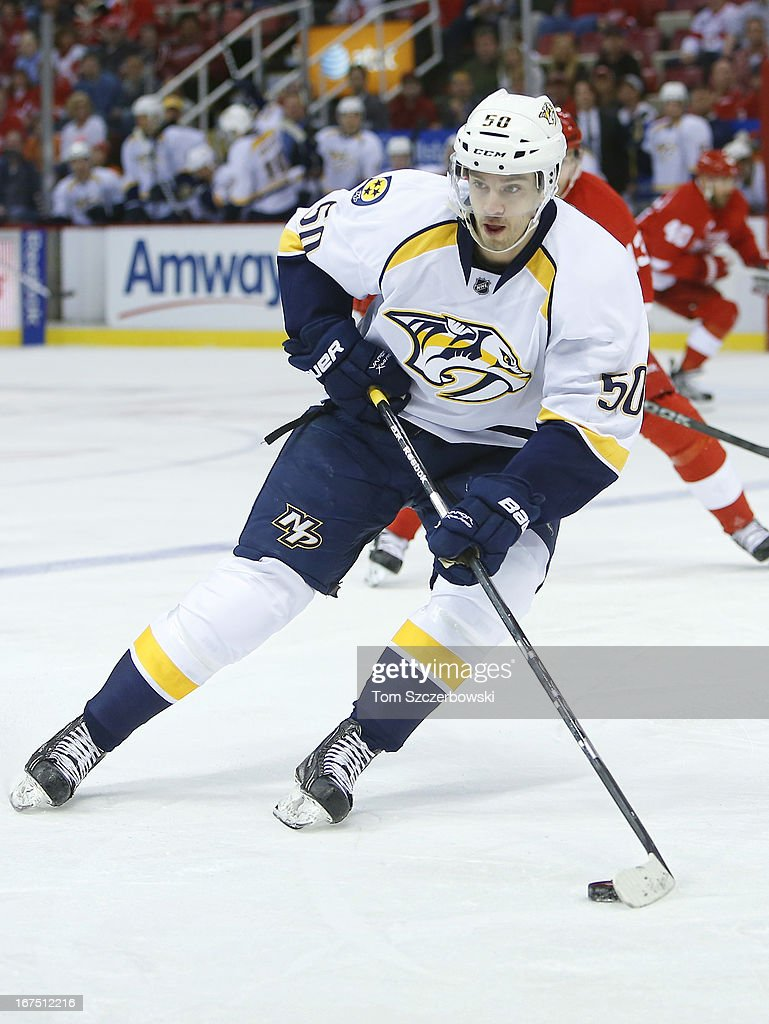 Daniel Bang #50 of the Nashville Predators picks up the puck during an NHL game against the Detroit Red Wings at Joe Louis Arena on April 25, 2013 in Detroit, Michigan.