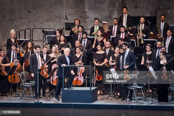 Daniel Barenboim and the WestEastern Divan Orchestra perform live during a concert at the Waldbuehne on August 19 2018 in Berlin Germany
