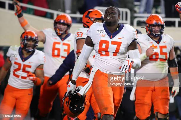 Daniel Barker of the Illinois Fighting Illini celebrates his fourth quarter touchdown to beat the Michigan State Spartans 37-34 at Spartan Stadium on...