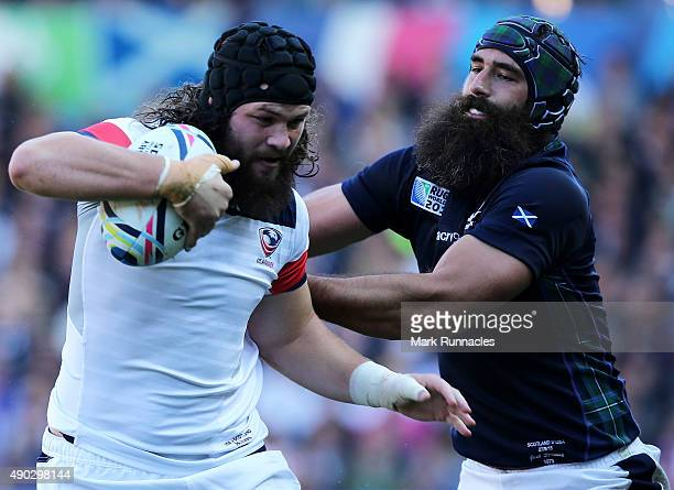 Daniel Barrett of USA is tackled by Josh Strauss of Scotland during the 2015 Rugby World Cup Pool B match between Scotland and USA at Elland Road on...