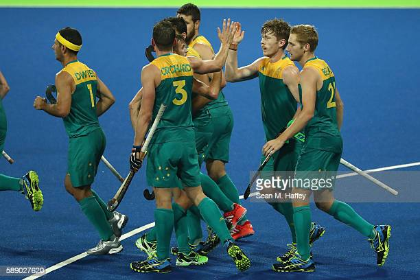 Daniel Beale Simon Orchard Matthew Dawson and Daniel Beale of Australia celebrate a goal against Brazil during a Men's Preliminary Pool B match on...