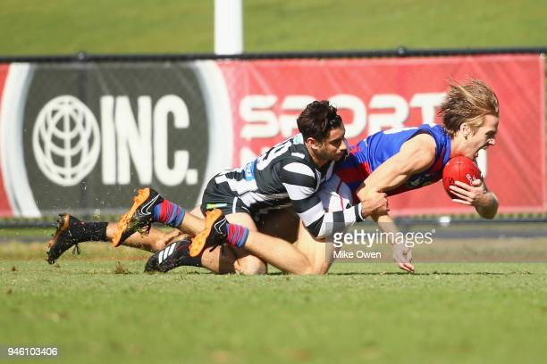 Daniel Beddison of Port Melbourne is tackled by Jack Blair of the Magpies during the round two VFL match between Collingwood and Port Melbourne at...