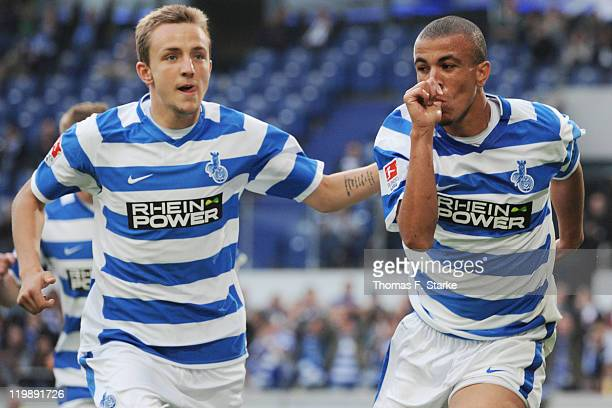 Daniel Beichler and Bruno Soares of Duisburg celebrate their teams second goal during the Loveparade charity match between MSV Duisburg and FC...