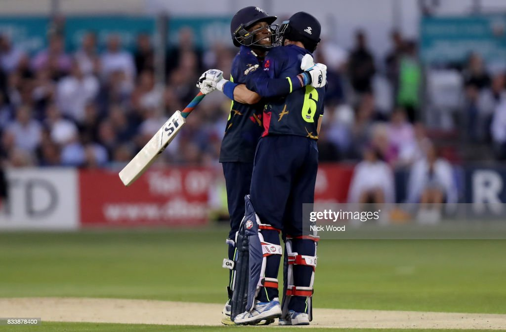 Daniel Bell-Drummond and Joe Denly of Kent celebrate scoring a world record opening during the Essex v Kent - NatWest T20 Blast (G) cricket match at the Cloudfm County Ground on August 17, 2017 in Chelmsford, England.