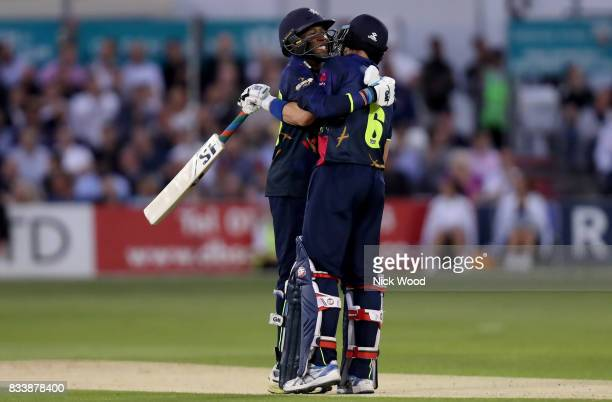 Daniel BellDrummond and Joe Denly of Kent celebrate scoring a world record opening during the Essex v Kent NatWest T20 Blast cricket match at the...