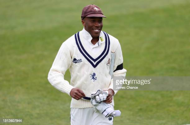 Daniel Bell-Drummond of Kent smiles as he warms up while wearing a black arm band in memory to Prince Phillip, Duke of Edinburgh during Day One of...