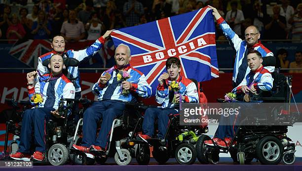 Daniel Bentley Nigel Murray and Zoe Robinson and David Smith of Great Britain celebrate winning bronze in the Mixed Team Boccia BC12 on day 6 of the...