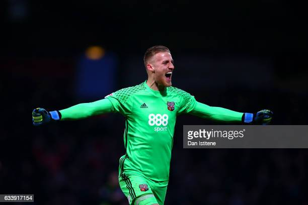 Daniel Bentley of Brentford celebrates after Konstantin Kerschbaumer of Brentford scored his team's third goal during the Sky Bet Championship match...