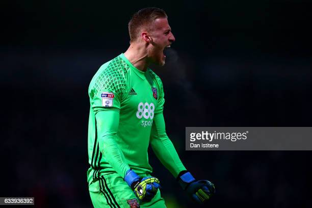 Daniel Bentley of Brentford celebrates after Konstantin Kerschbaumer of Brentford scored his team's third goal during the Sky Bet Championship match...