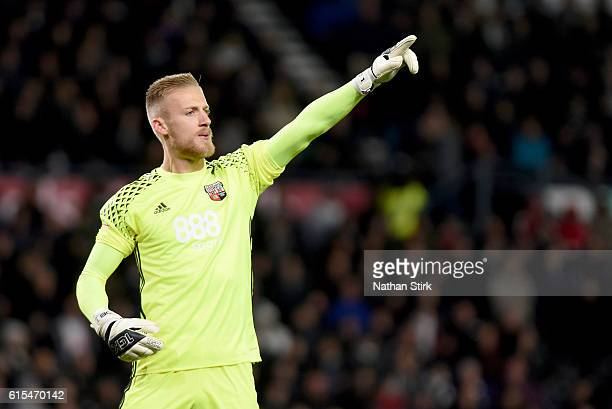 Daniel Bentley of Brentford gives instructions to his team mates during the Sky Bet Championship match between Derby County and Brentford at iPro...