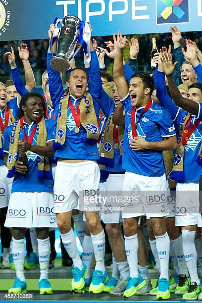 Daniel Berg Hestad of Molde FK celebrates victory with his teammates after winning the Tippeligaen 2014 on November 9 2014 in Molde Norway
