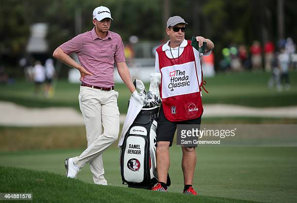 Daniel Berger and his caddie are seen on the third hole during the third round of The Honda Classic at PGA National Resort Spa Champion Course on...
