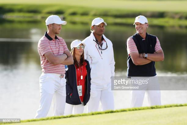 Daniel Berger Captain's assistant Tiger Woods Captain Steve Stricker of the US Team and Erica Herman talk during Friday fourball matches of the...