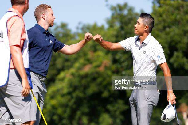 Daniel Berger of the United States bumps fists with Collin Morikawa of the United States on the 17th green after defeating him during a playoff in...