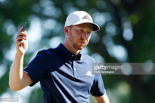 Daniel Berger of the United States celebrates defeating Collin Morikawa of the United States on the 17th green during a playoff to win in the final...