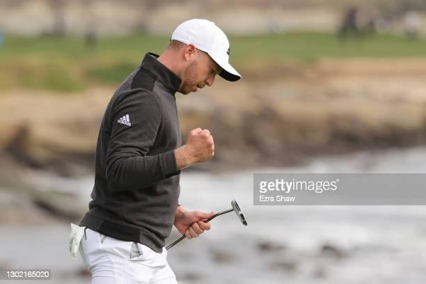 Daniel Berger of the United States celebrates his eagle putt to win on the 18th green during the final round of the AT&T Pebble Beach Pro-Am at...