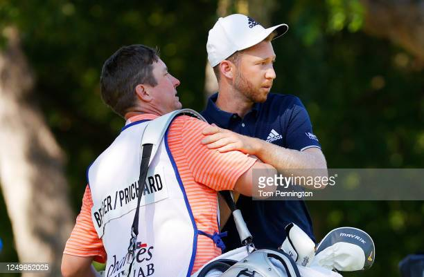 Daniel Berger of the United States celebrates with his caddie on the 17th green after defeating Collin Morikawa of the United States during a playoff...