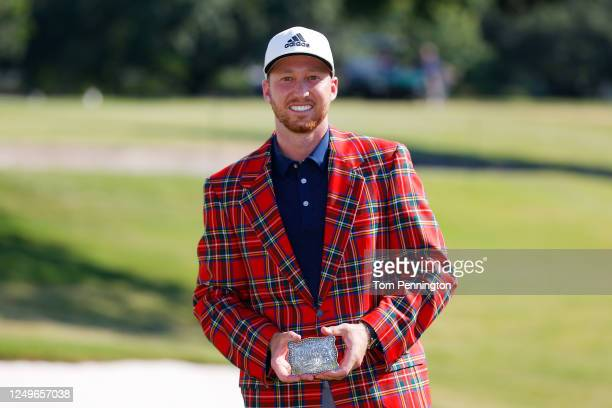 Daniel Berger of the United States celebrates with the plaid jacket and belt buckle after winning in a playoff during the final round of the Charles...