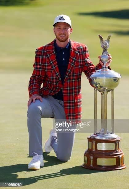 Daniel Berger of the United States celebrates with the plaid jacket and trophy after defeating Collin Morikawa of the United States in a playoff...