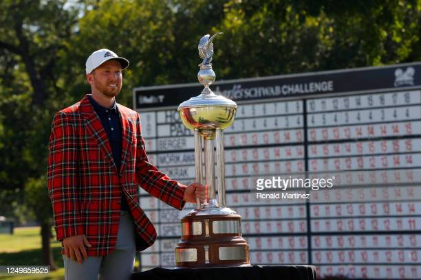 Daniel Berger of the United States celebrates with the plaid jacket and Leonard trophy after defeating Collin Morikawa of the United States in a...