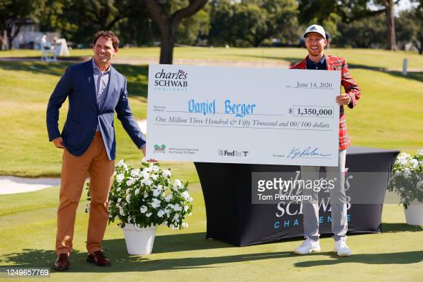 Daniel Berger of the United States celebrates with the winner's check after defeating Collin Morikawa of the United States in a playoff during the...